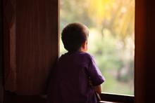Little Boy Standing Alone Look...