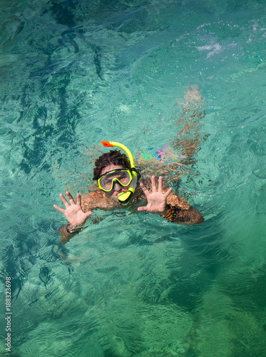 Fototapeta Woman with mask snorkeling in clear  water obraz na płótnie