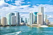 canvas print picture - miami skyline. Yachts sail on sea water to city