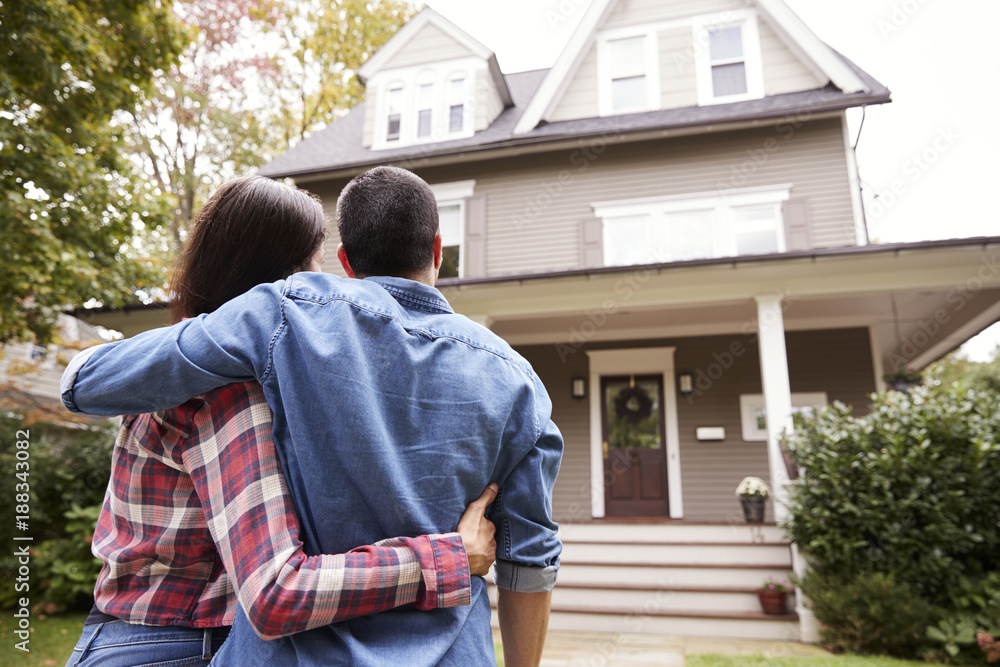 Fototapeta Rear View Of Loving Couple Looking At House
