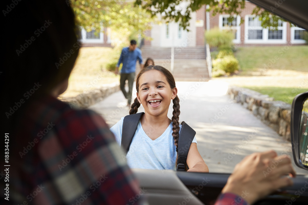 Fototapety, obrazy: Mother In Car Collecting Daughter In Front Of School Gates