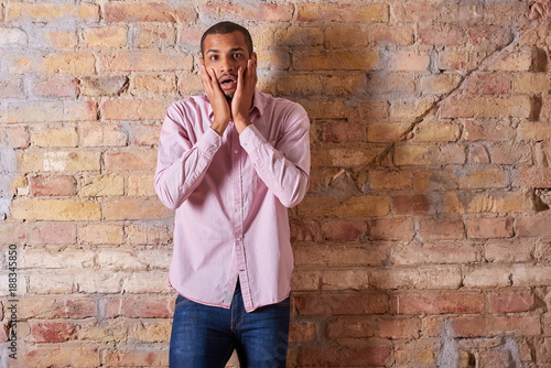 f2fb5339 Portrait of a surprised handsome young man in a pink shirt. - Buy ...