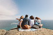 canvas print picture - Group of friends enjoying view from top of a hill