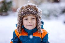 Happy Kid Boy Having Fun With Snow In Winter