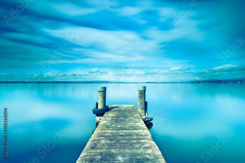 Fototapeta Halftone color. Abstract landscape. Wooden pier on Lake Zug in Switzerland. Long exposure.