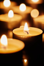 Burning Tea Light Candles In D...