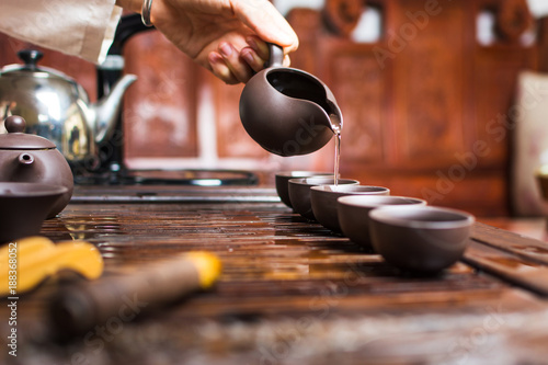 Fotografie, Obraz  Woman pouring traditionally prepared Chinese tea