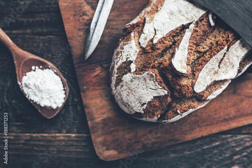 Foto op Plexiglas Bakkerij Delicious fresh bread on wooden background