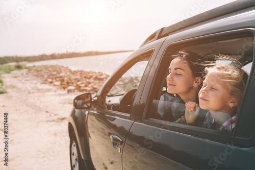 Fotografia, Obraz Happy family on a road trip in their car