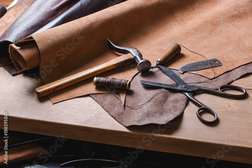 Cobbler tools in workshop on the wooden table . Top view. Canvas Print
