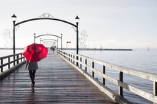 Woman Holding A Red Umbrella W...