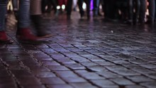 People Crossing Square. Flow On Paving Stone. Evening. Crowd. Wet Pavement.