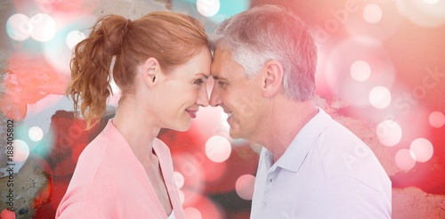 Composite image of casual couple smiling at each other