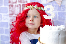 Girl Holding Cake During Princess Party