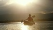 Kayaker paddling at amazing sunset and water droplets splashing. Satisfied happy summer vacation tourist rest relax and recreation. Slow motion. 1920x1080