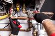 Leinwanddruck Bild - plumber fixing central heating system