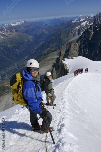 Poster Climbers make their way along a ridge near the Aiguille du Midi on Mont Blanc Ch