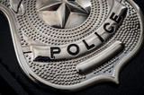 """Cops and police officer badge with macro close up on the """"police"""" text of a  cop badge"""