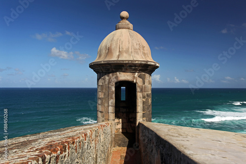 Photo sur Aluminium Fortification A Sentry Box of the El Morro Fortress in San Juan, Puerto Rico on a sunny Day with blue Sky and Sea