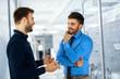 Two businessman having a conversation in hallway