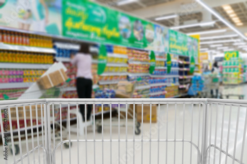 Spoed Foto op Canvas Gondolas Trolley Shopping Kart in supermarket surround by shelves or Gondola at store