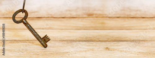 Life coaching concept - key standing on a wooden background - web banner with blank, copy space