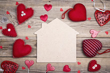 Home Symbol With Red Hearts On Wooden Background With Copy Space.