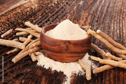 Photo  Ashwagandha powder in wooden bowl