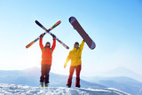Active skier and snowboarder against mountains