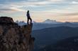 Leinwanddruck Bild - Adventurous man on top of the mountain during a vibrant sunset. Taken on Cheam Peak, near Chilliwack, East of Vancouver, British Columbia, Canada.