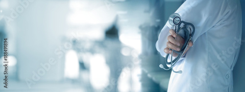 Fotografía  Doctor with stethoscope in hand on hospital background, medical and medicine con