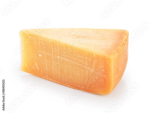 Piece of parmesan cheese isolated on white background.