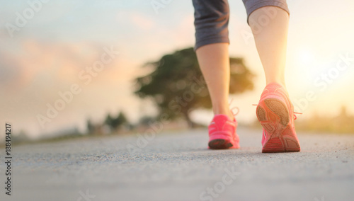 Poster Jogging Athlete woman walking exercise on rural road in sunset background, healthy and lifestyle concept