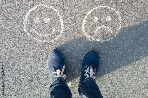 Fotografía  Happy Smileys or Unhappy, text on asphalt road