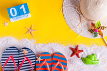 February 1st. Image Of February 1 Calendar With Summer Beach Accessories And Traveler Outfit On Background. Winter Like Summer Vacation Concept