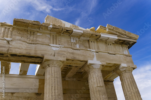 Athens Acropolis Parthenon temple detail with remaining columns and roof structure. Day view of the ruins of the temple that dominates the hill of the Acropolis at Athens, dedicated to goddess Athena