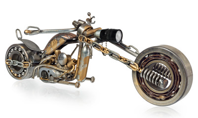 Obraz Handmade motorcycle, chopper, cruiser composed of metal parts, bearings, śtubokrętów, candles motor, wires, chains.