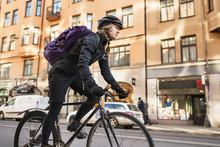 Woman Riding Bike In City