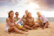 Big family having fun at the beach