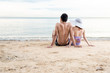 couple sitting together relaxing on paradise beach