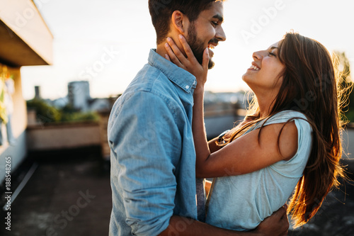 Beautiful couple in love dating outdoors and smiling Canvas-taulu