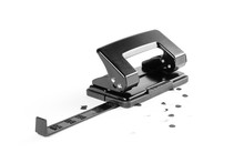 Black Hole Punch For Paper On White Background. Closeup
