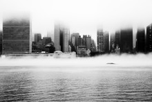A Dense Fog Covered New York City During The Winter's Day On January Of 2018. View Of Manhattan And United Nations Building.