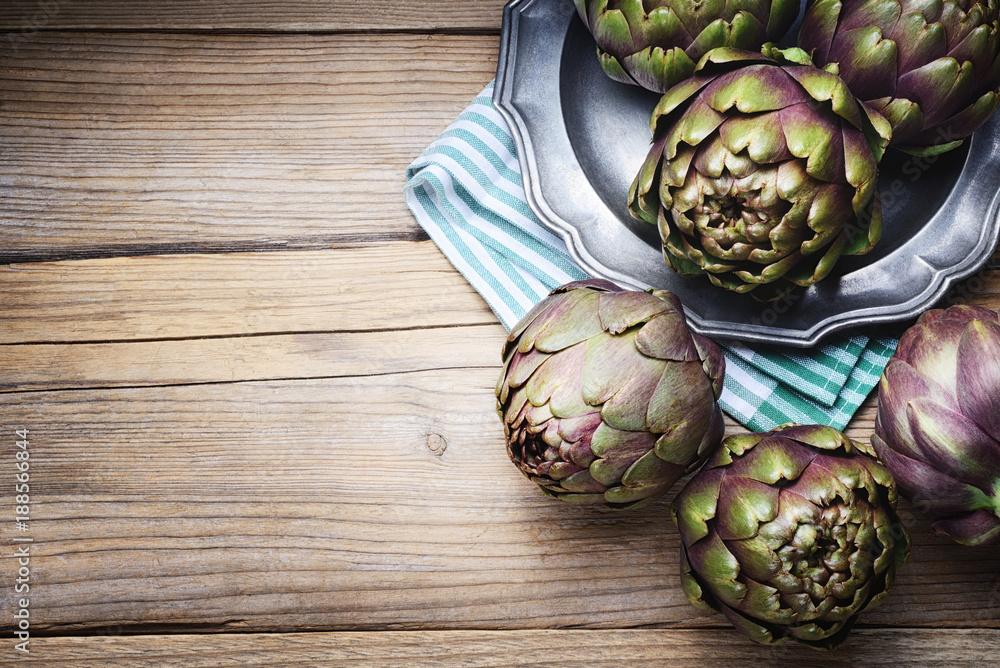 Fototapety, obrazy: Artichokes on a wood background. Top view with space for text