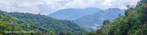 Fotobehang Khaki Panorama view of Mon Jam Mountain valley in the daytime with cloudy sky background