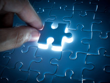 Missing Jigsaw Puzzle Piece With Lighting, Business Concept For Completing The Finishing Puzzle Piece