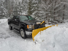 Snow Plow Clearing A Parking L...