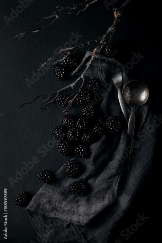monochrome food picture of blackberries on a napkin and slate plate kitchen table can be used as background