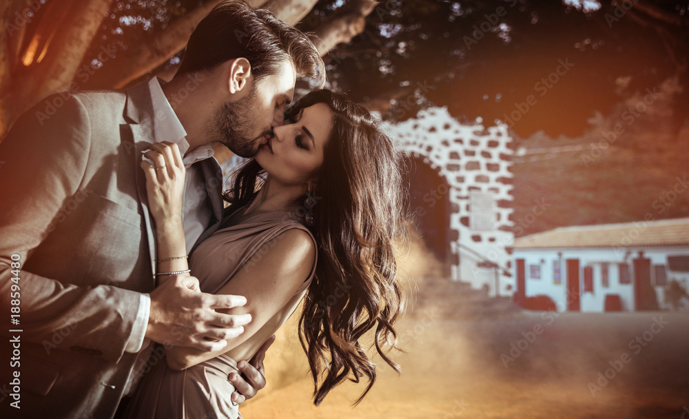 Fototapeta Portrait of an elegant, kissing couple