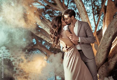 Portrait of an elegant, kissing couple